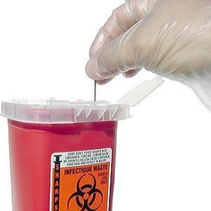 used needles are placed into a sharps container