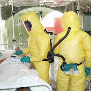 Patient with Ebola in isolation, staff in protective equipment