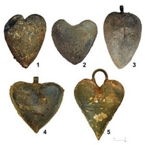 picture of the five heart-shaped lead urns