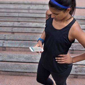 girl using Fitbit fitness watch