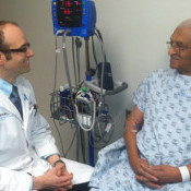 Dr Robert Den with a prostate cancer patient in 2013