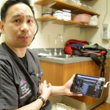 Dr. James Tsung, MD, showcases a lung ultrasound display on a tablet. Credit: Image courtesy of Mount Sinai Health System
