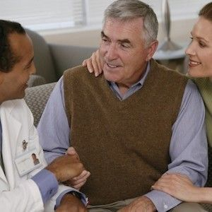 Stock photo, doctor talking to a man and woman, credit American Thoracic Society