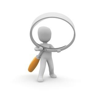 Figure holding magnifying glass, credit Pixabay