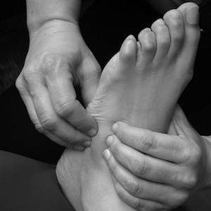 Foot being massaged