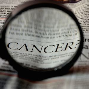 Cancer written in newspaper, credit Pixabay