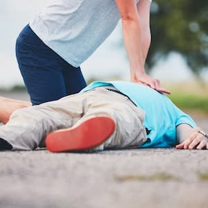 bystander CPR on rural road, credit: iSTock